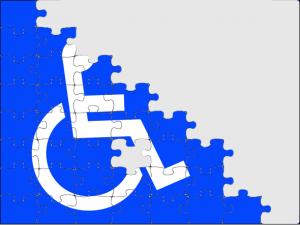 Disability wheelchair icon against blue stairs with a puzzle edge